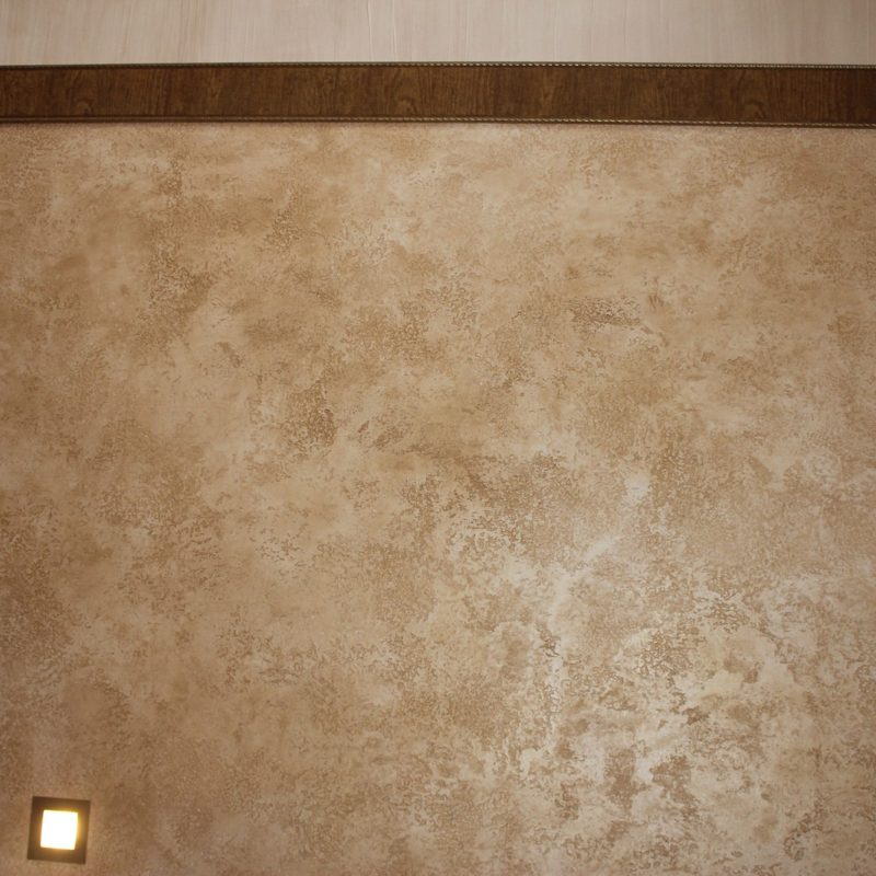 The flight of stairs is covered with durable decorative plaster Travertine