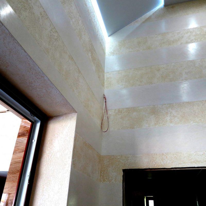 Textured travertine base and marmorine strips